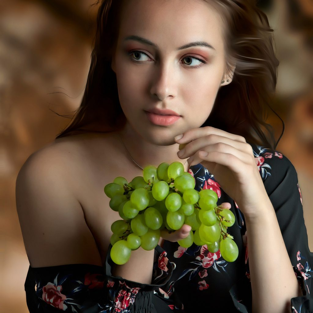 Girl with grapes